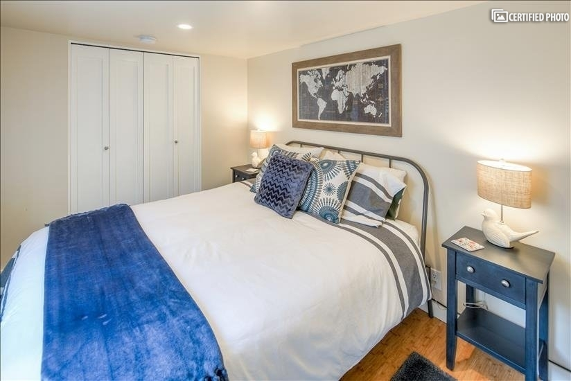 Queen sized bed & end tables in the smaller bedroom