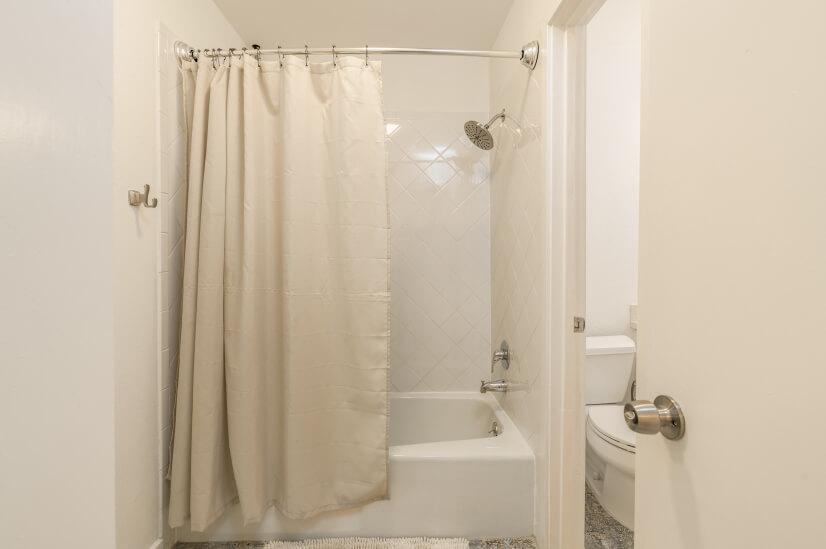 Shower/Bath adjoins two bathrooms