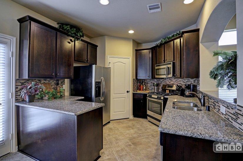 Espresso cabinets and granite counters