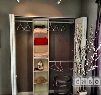 Spacious closet in bedroom.