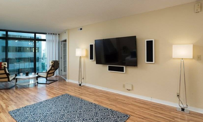 "Living room with 65"" TV and Premium Speakers from Sweden"