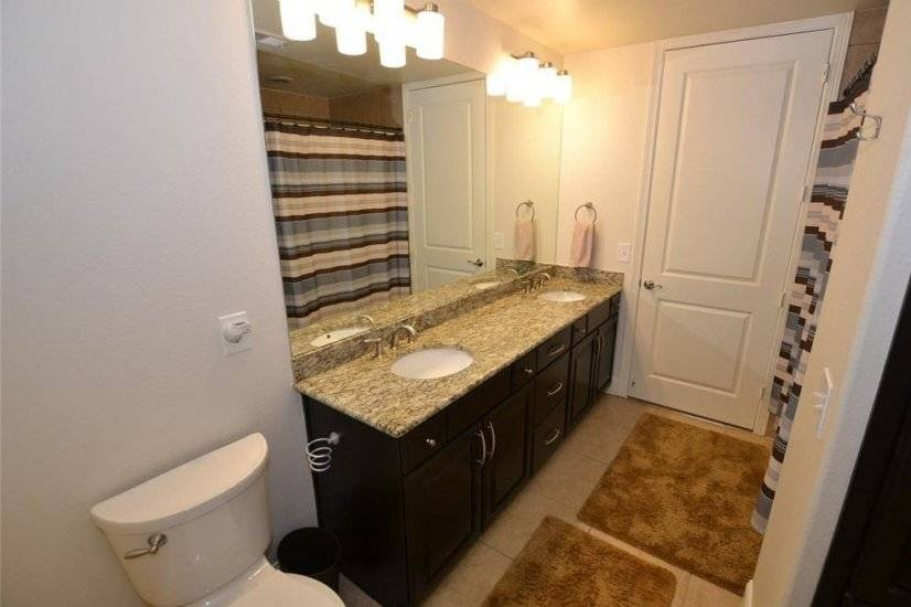 Two Sink Vanity with Full Tub and Shower