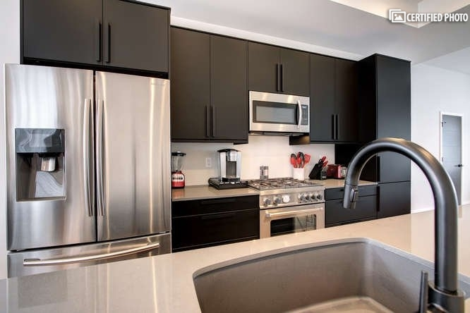 High-end appliances and sleek counter tops