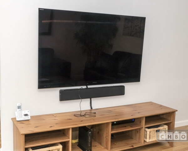 Two large screen Roku TVs; living room w bluetooth soundbar