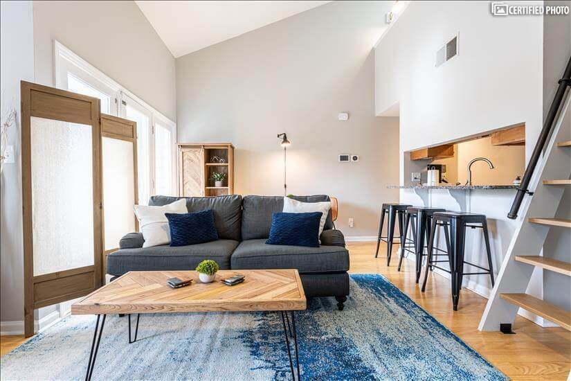 Open concept with bar seating and table for t