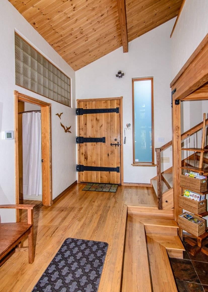 Hand crafted front door.  Bathroom on left