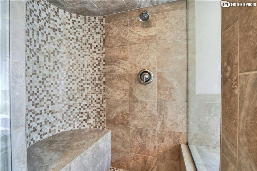 Master Bathroom custom tile shower with jacuzzi tub adjacent