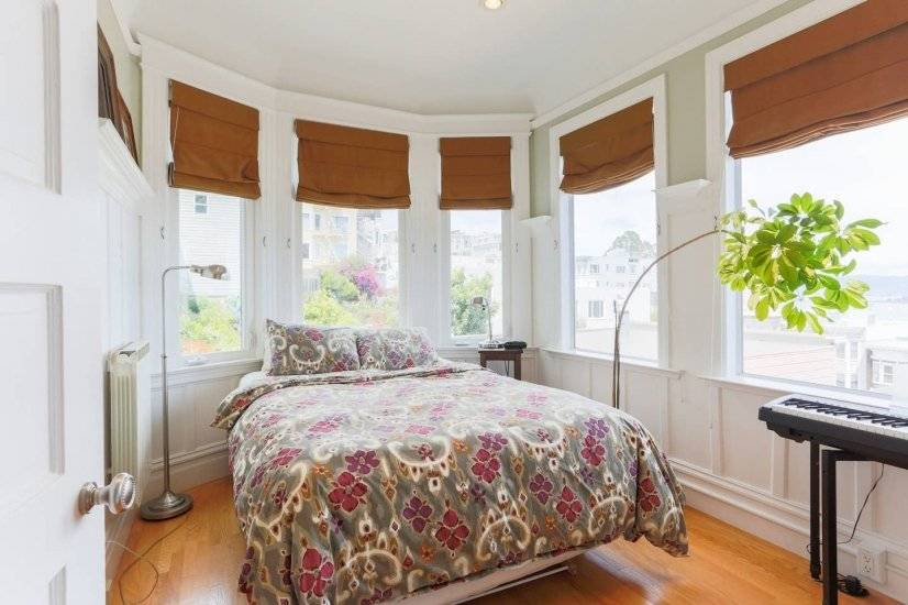 3rd Queen bedroom with 2 walls of oversized windows