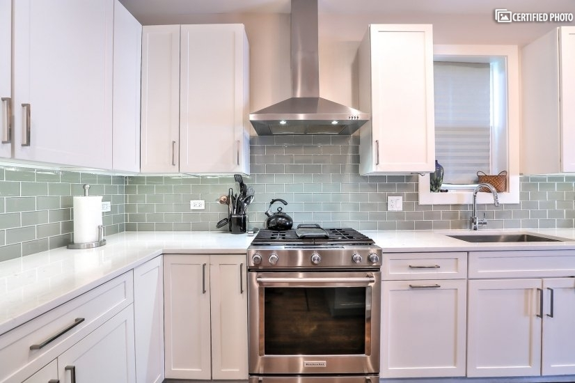 Grand Kitchen with Quartz countertops