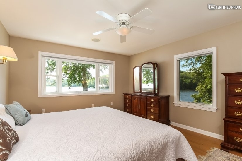 Master Bedroom overview photo. Beatiful view of lake.