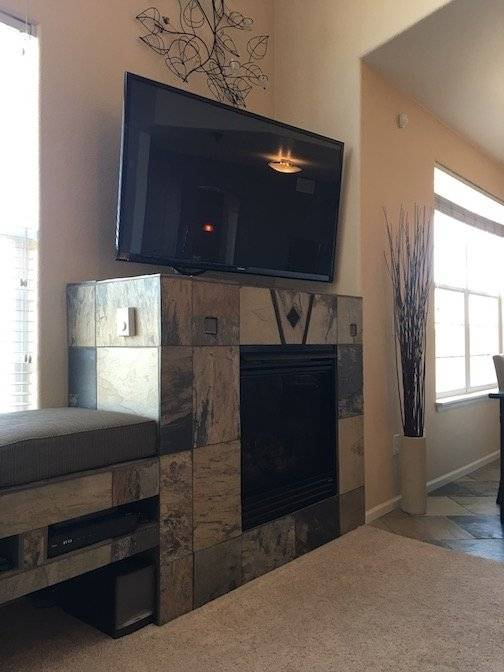 living room fireplace and big screen TV