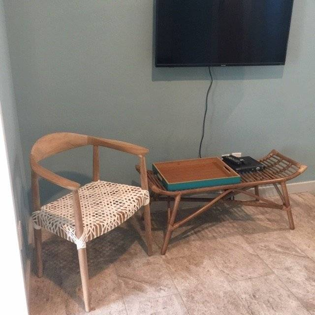 2nd floor wallmounted TV, leather strapped teak chair, table