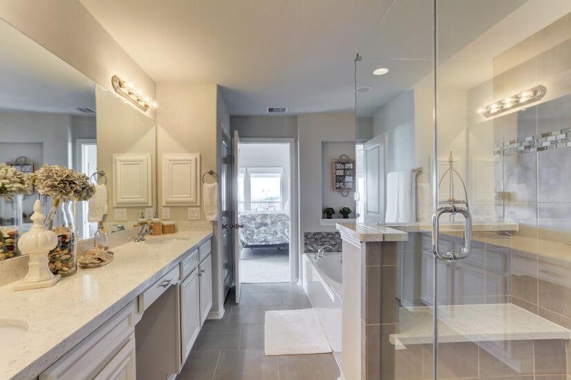 Double sinks, oversized tub, frameless shower in master.