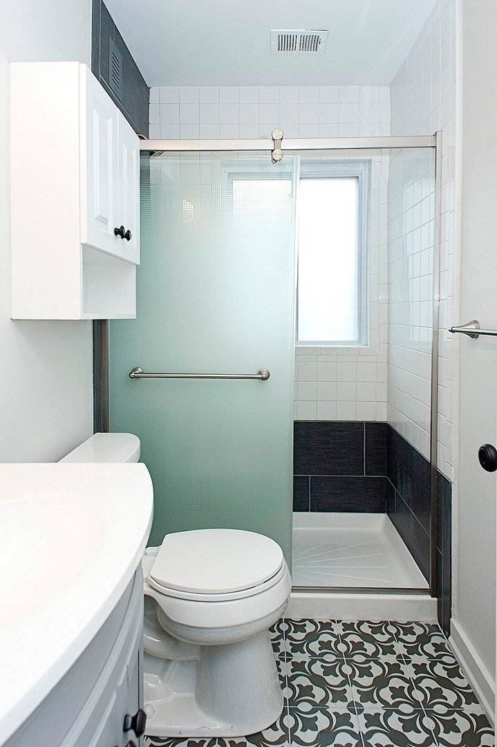 completely renovated bathrooms with tile floors and walls