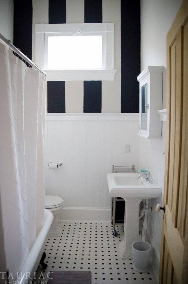 Striped walls in bathroom.