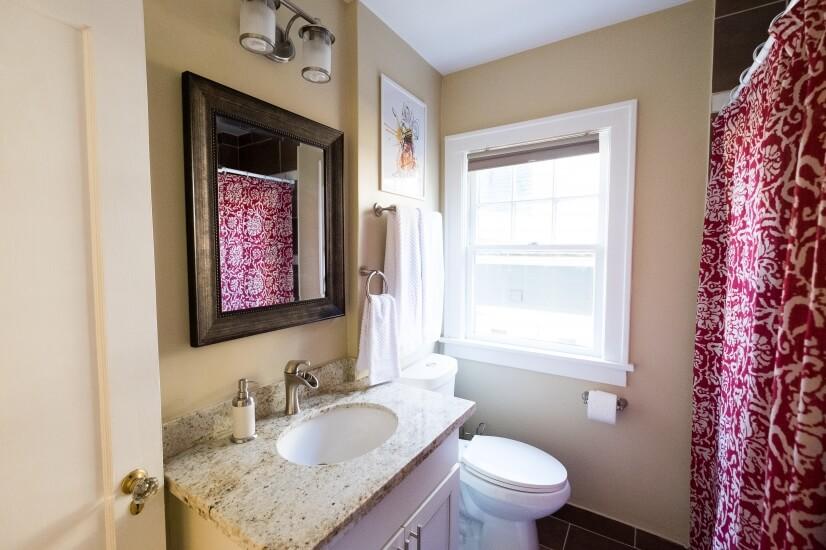 Bright bathroom, granite countertops, Italian tile.