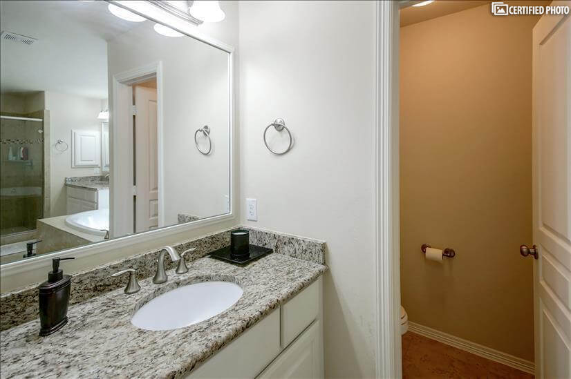 His and her separate vanities and bathroom
