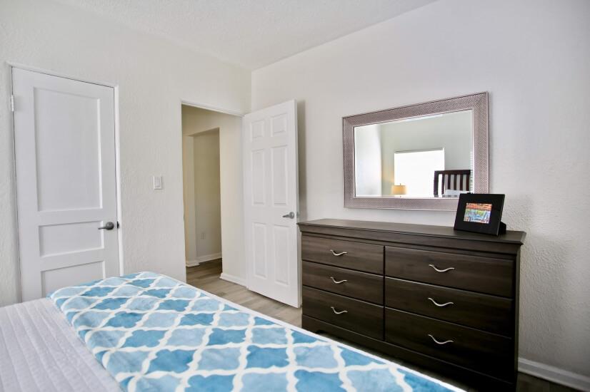 Nightstand, alarm clock, ceiling fan, closet & dresser