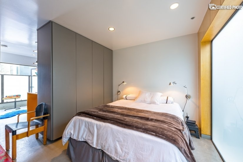 Tranquil sleeping space with floor to ceiling closets.