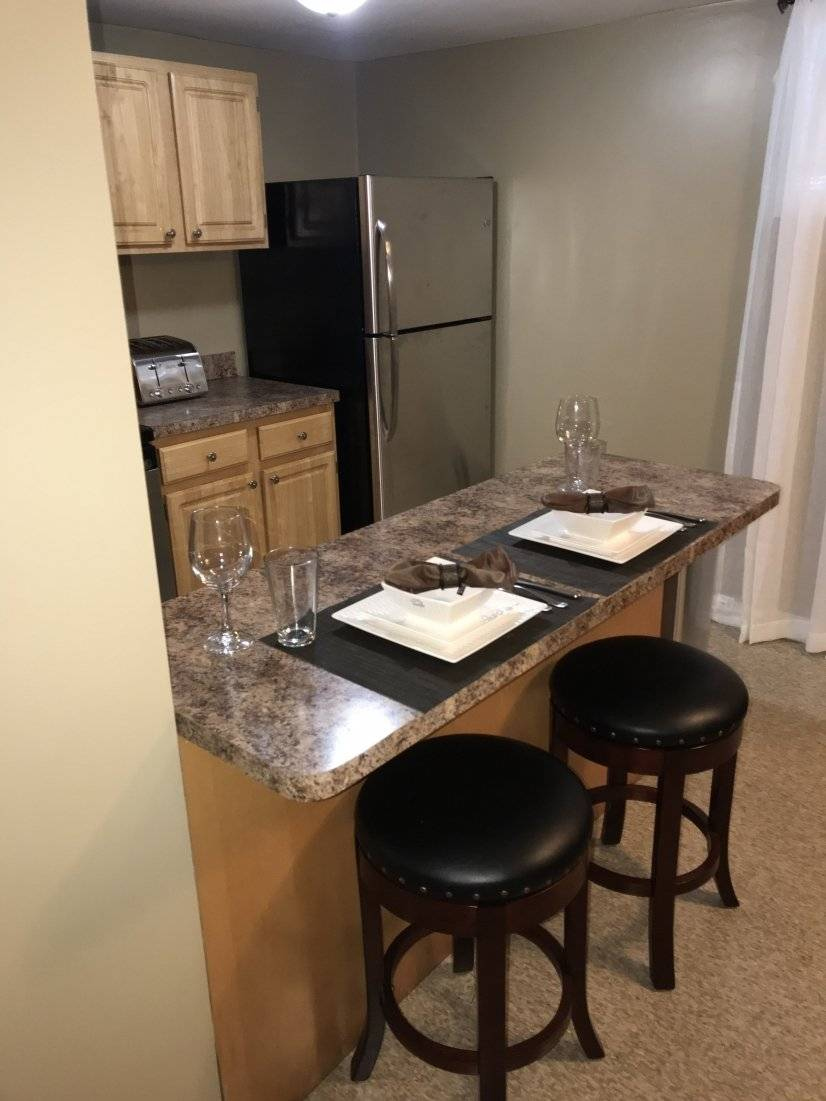 Kitchen leather stools at island.