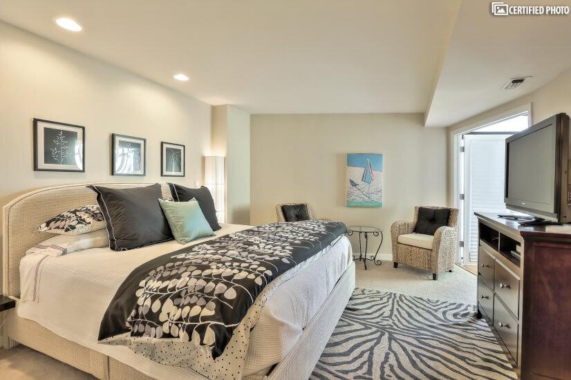 Custom upholstered King Bed with Designer Linens