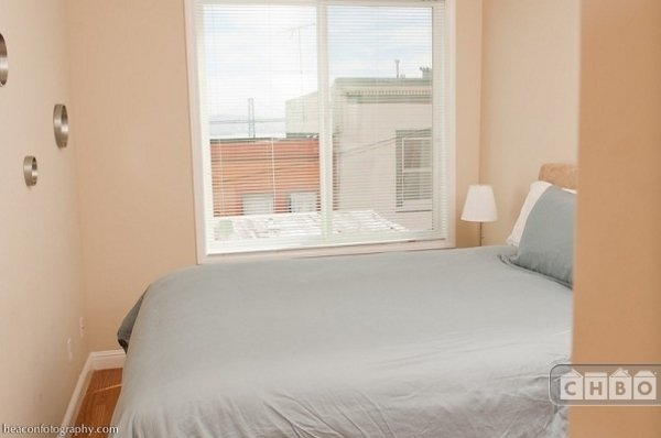 2nd Bedroom with Queen bed and bridge views.