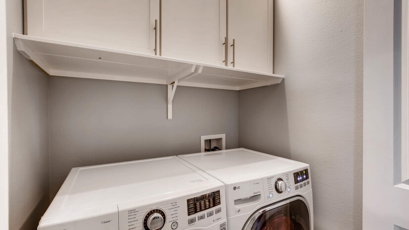 Closeted laundry room, LG washer and dryer
