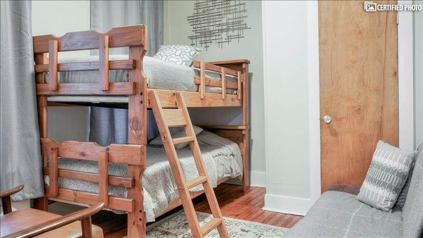 a solid wood bunk twin beds with an additional sofa bed