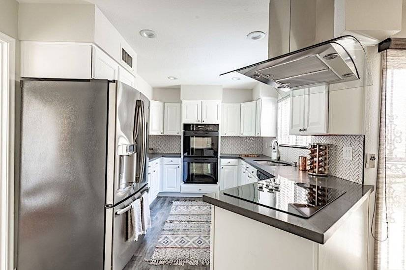 Kitchen - Large stainless steel fridge, electric cooktop