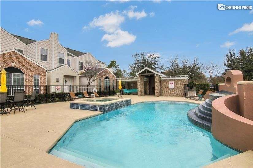 Small gated community with resort style pool and trails!