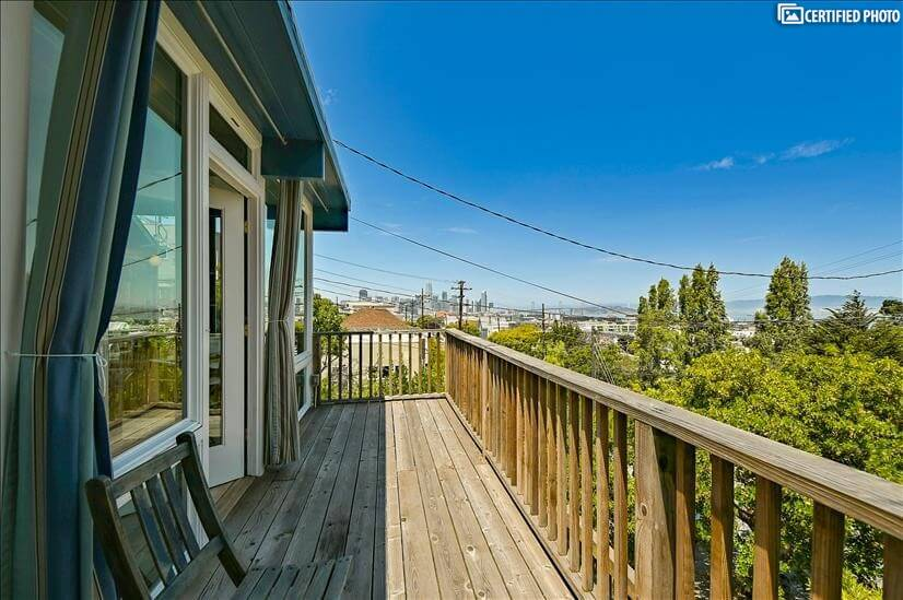 Front deck with views of downtown and the Bay Bridge.