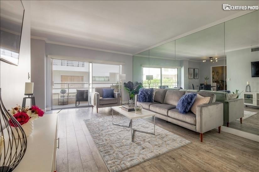 Spacious living room, & furnished balcony!