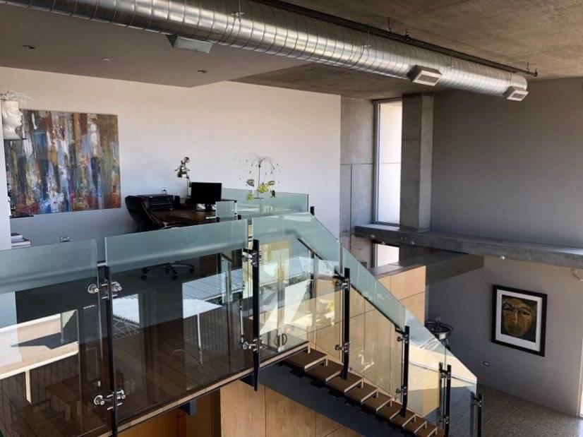 Office space overlooks the kitchen.