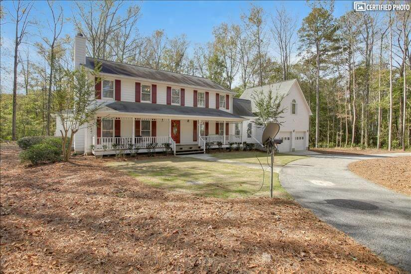 Large driveway and garage with beautiful fron