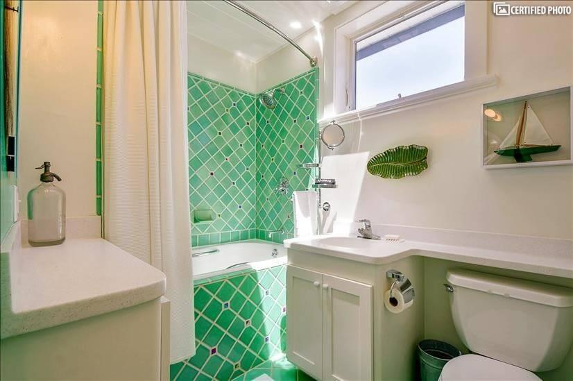 First bathroom has a rainfall shower and a skylight.