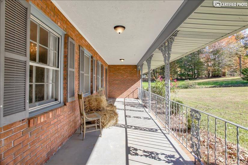 Great front porch to sit and enjoy the outdoo