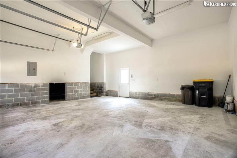 Tall ceilings in two car garage area.