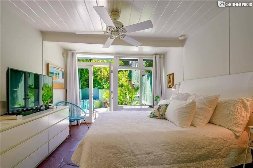 Master bedroom with double door view of the garden.