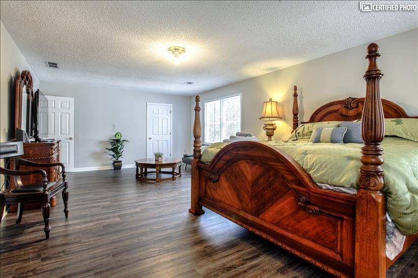 Large king sized bed and walk in closet.