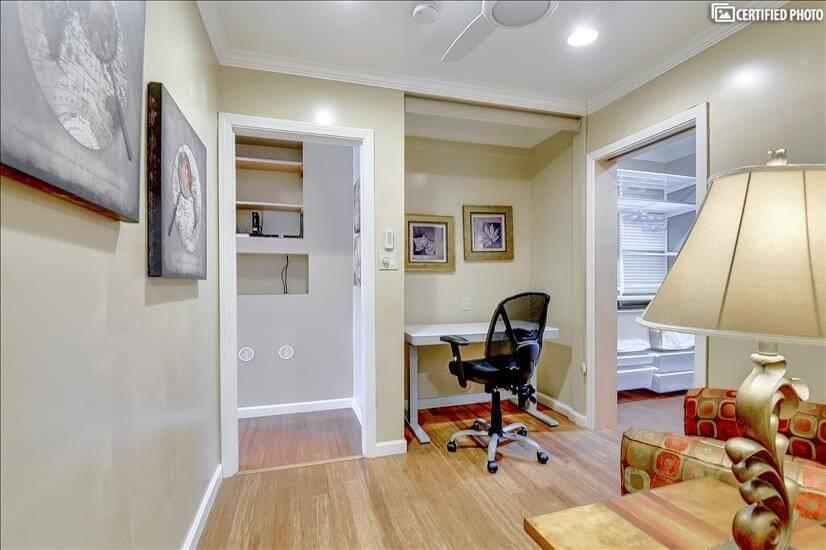 Office with standing desk, 2 comfy chairs and