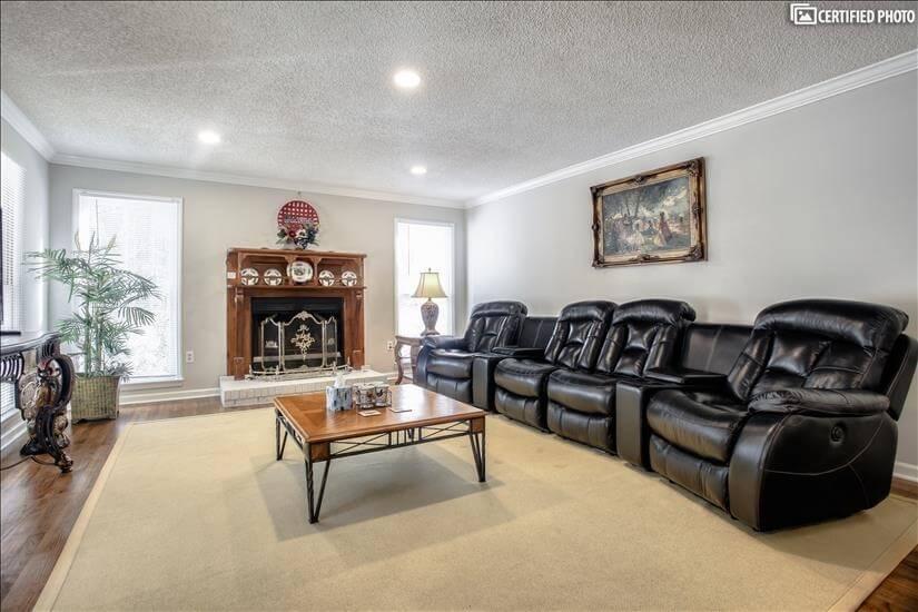 Living room just inside front door to left.