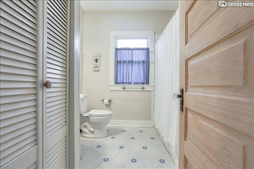 Main bathroom. Gorgeous original glass doorkn