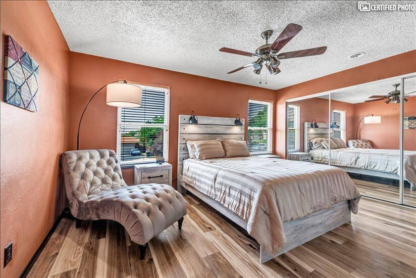 Master bedroom with reading chase & lamp
