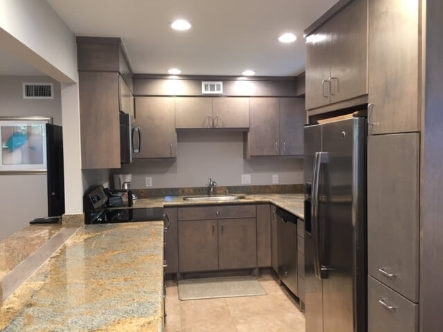 Kitchen with Stainless Steel Appliances Granite Counter Tops