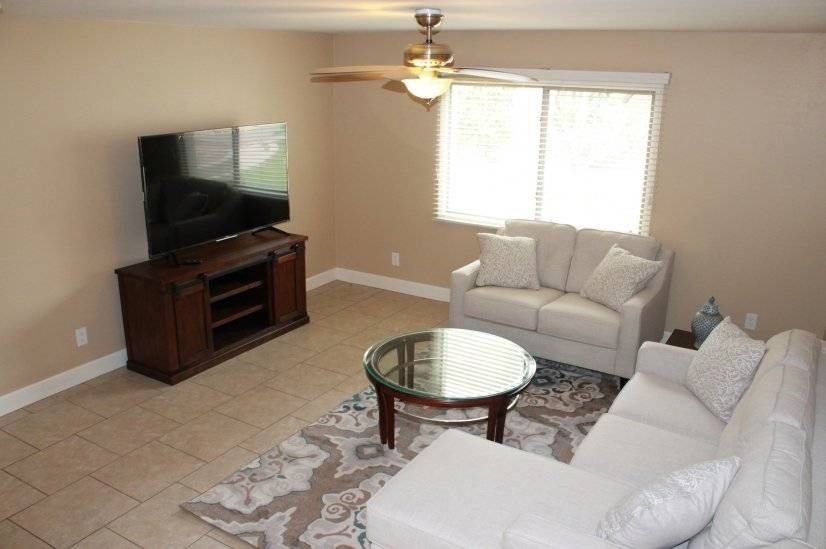 Spacious, comfortable living room with 65' flat screen TV