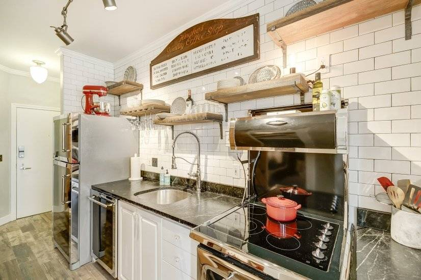 Features high-end Heartland appliances with subway tile
