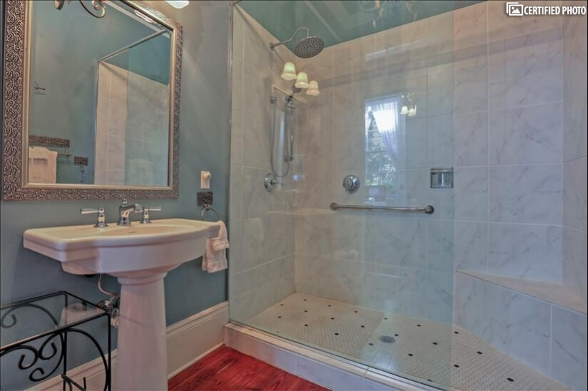 Roomy guest bathroom with extra large walk in shower