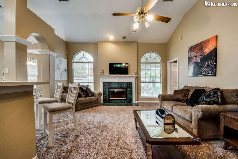 Family room view w/gas fireplace opens to kit