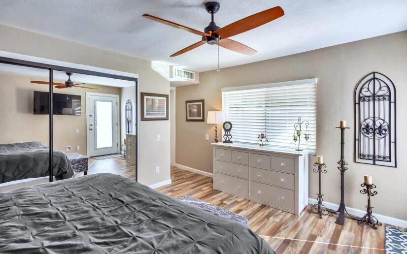 """Master Bedroom. 65"""" Smart TV. King-Size Bed. Backyard Door"""
