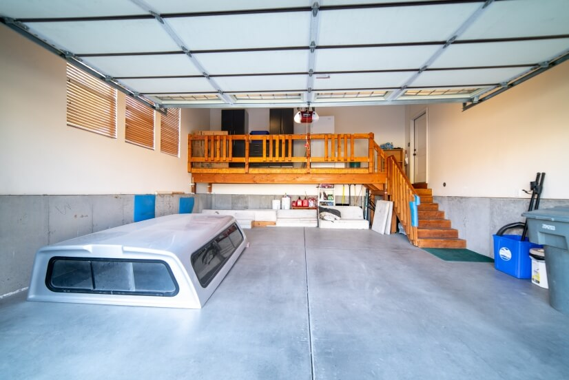 Garage with overhead storage & outside fridge